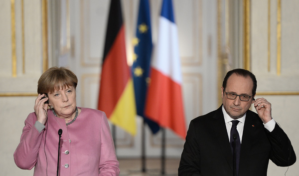 Hollande, Merkel express same will to address migration crisis