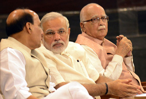 Be humble, visit constituencies, dont touch my feet: Modi to BJP MPs