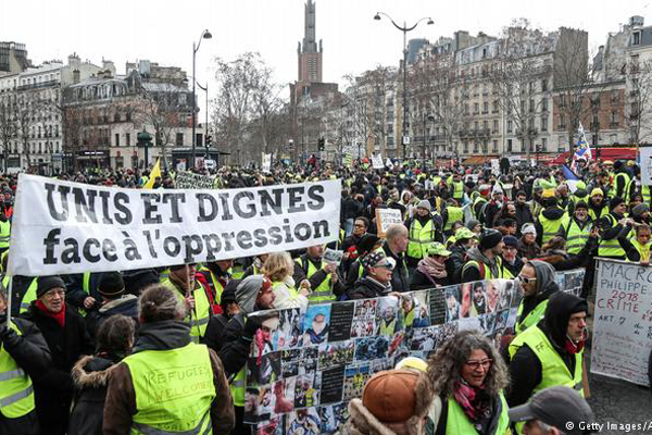Thousands protest in Paris against police violence