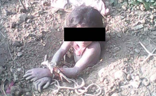 Man held for attempting to bury daughter alive