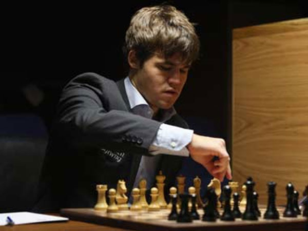 Magnificent Magnus punishes Anands misadventure, retains world chess title