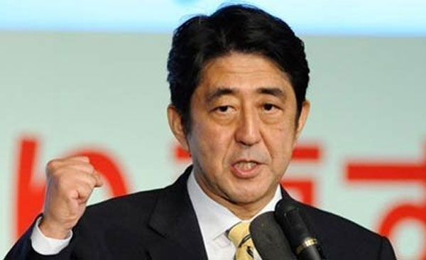 Japan PM to dissolve lower house, delays sales tax hike