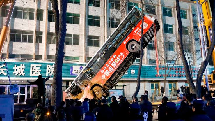 Six killed as China sinkhole swallows bus