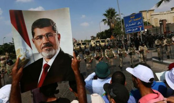 Egypt court jails 17 Morsi loyalists up to 25 years
