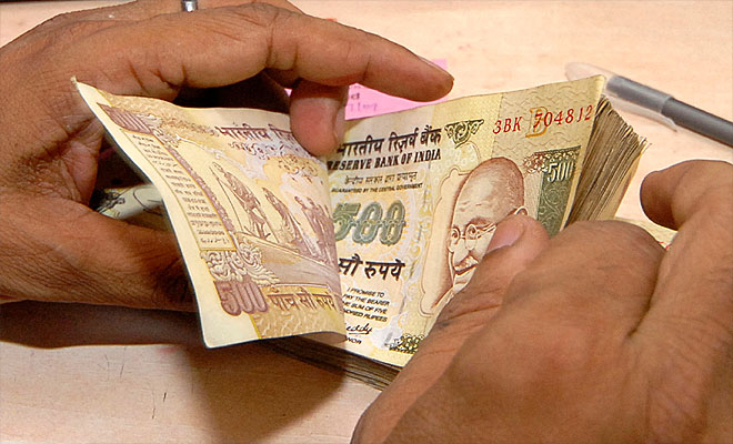 Rupee falls to historic low of 62 per dollar, Sensex plunges over 400 points