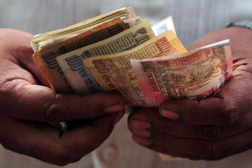 Rupee falls 50 paise against dollar in early trade