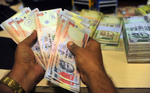 Rupee gains 138 paise against dollar on RBI steps