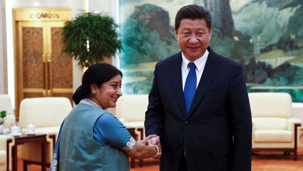 Xi meets Sushma, upbeat about growth of India-China ties