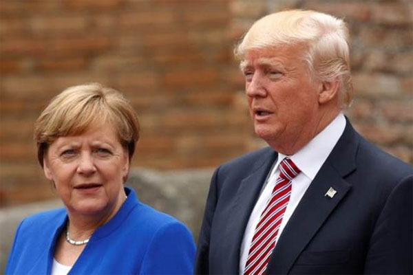 Ahead of G20, Trump discusses climate change with Merkel