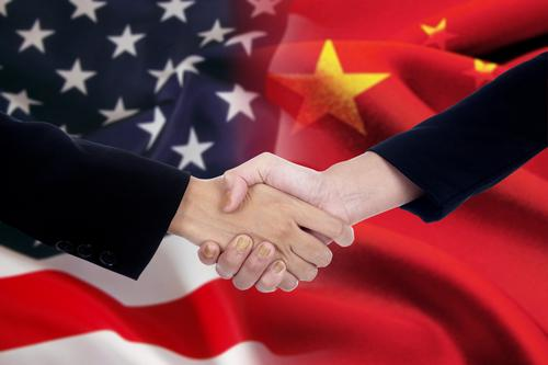 Under the gun, China, US begin trade talks