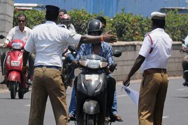 Kerala cops crack down on pillion riders without helmets