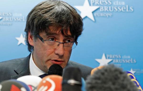 Belgium court releases sacked Catalonian leader Puigdemont on condition