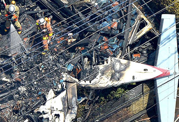 Small plane crashes into Tokyo residential area, three feared dead