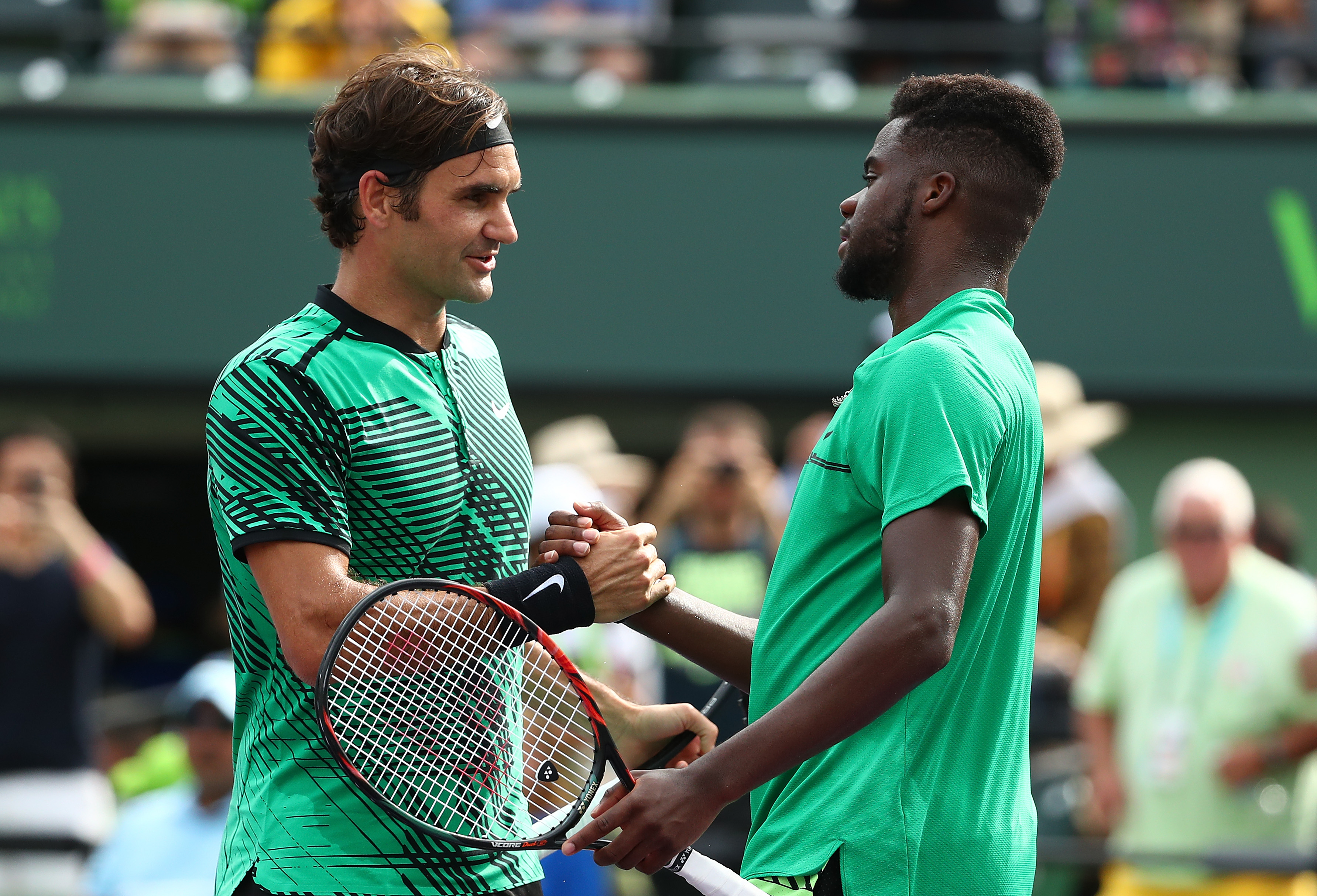 Federer, Wawrinka advance in Miami