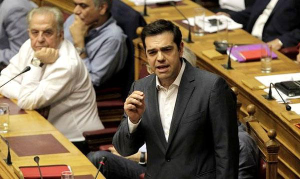 Greeks parliament approves debt deal, reforms to avert Grexit