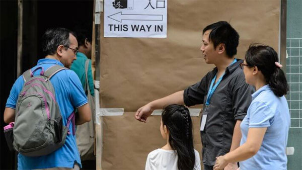 Pro-democracy leader leads in Hong Kong polls