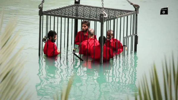 IS video shows drowning of five spies in a cage