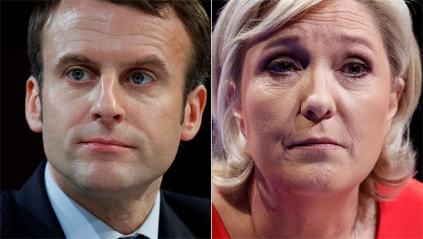 Macron tops French election, to fight Le Pen in second round
