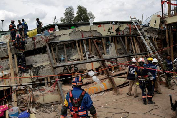 Mexico quake toll 361; 8 still missing in collapsed building