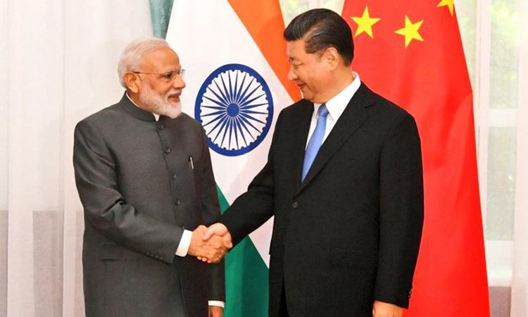 PM Modi meets Xi Jinping on sidelines of SCO summit in Astana