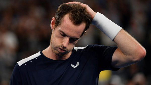 Murray crashes out as Federer, Nadal fight on