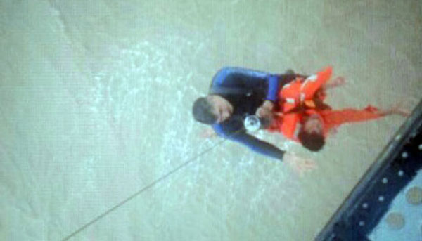 Navy, Coast Guard rescue 14 crew members from sinking vessel