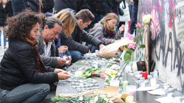 One Paris attacker identified, France mourns