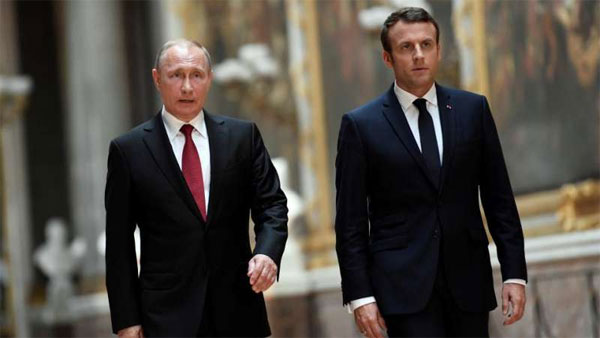 Emmanuel Macron meets Putin, warns over Syrian chemical weapons