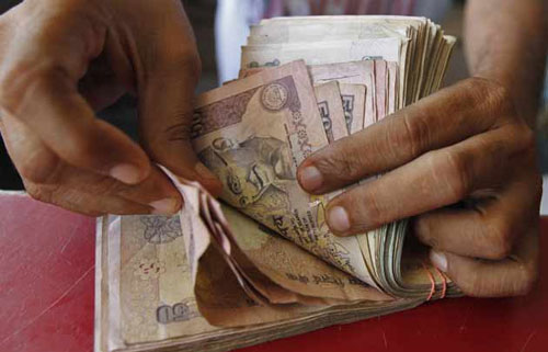 Rupee hits record low of 58.35; further losses likely