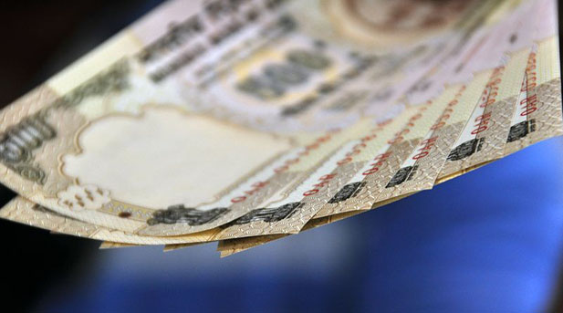 Rupee slips below 60 against dollar; hits new record low