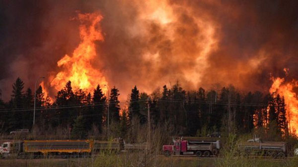 Raging wildfire spreads to more areas in west Canada