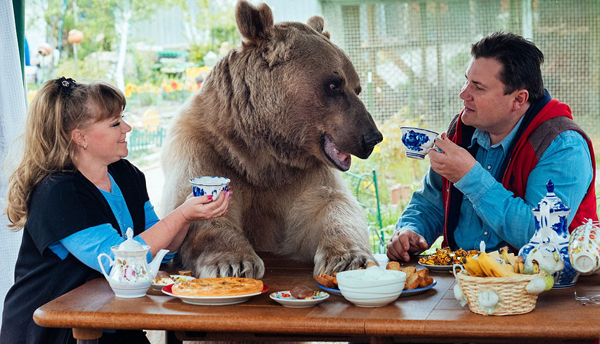 This Russian couple shares their home with a 7-foot tall bear