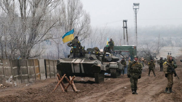 Both sides agree to start heavy weapons pullback in Ukraine