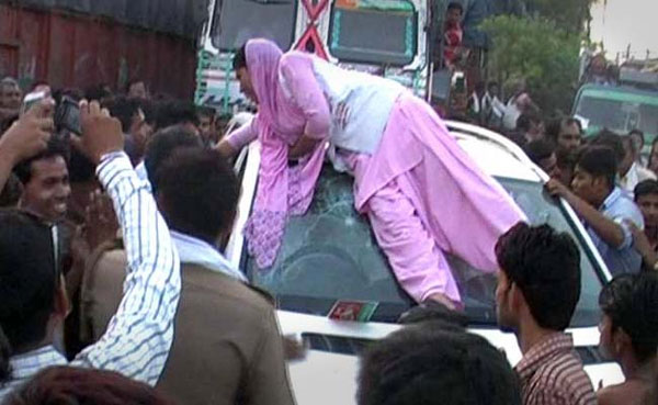 Teased by gunner, woman smashes local SP leaders Mercedes