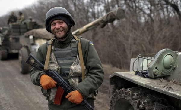 Ukraine starts heavy weapons withdrawal